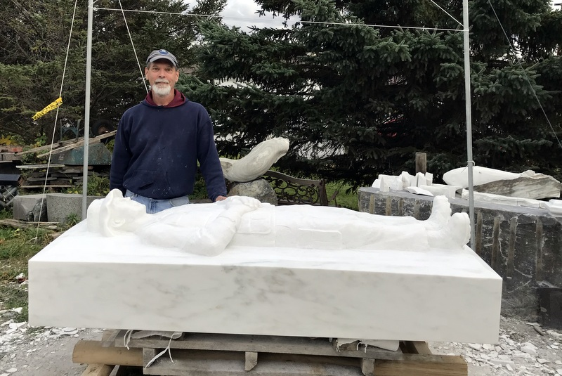 Sculptor, Don Ramey behind the new memorial preparing to move it from West Rutland
